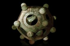 The Roman dodecahedron is a small, hollow object made of bronze or (more rarely) stone, with a geometrical shape that has twelve flat faces. Each face is a pentagon, a five-sided shape. The Roman dode Unexplained Phenomena, Unexplained Mysteries, Ancient Mysteries, Ancient Artifacts, Roman Britain, Archaeological Discoveries, Beautiful Mind, Ancient Romans, Ancient Civilizations
