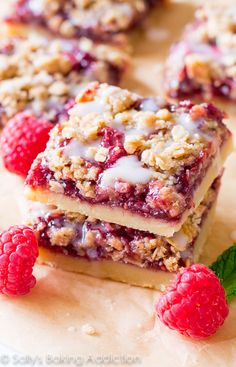 These Raspberry Streusel Bars are so simple to make and have four delicious layers. From the shortbread crust to the streusel topping and sweet vanilla glaze, there isn't one bite you won't enjoy! Cookie Desserts, Just Desserts, Cookie Recipes, Delicious Desserts, Yummy Food, Dessert Recipes, Raspberry Crumble Bars, Raspberry Desserts, Raspberry Filling
