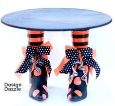 How cute is this cake stand?  Thrift store boots spray painted and Plastic cups for legs ... Love it