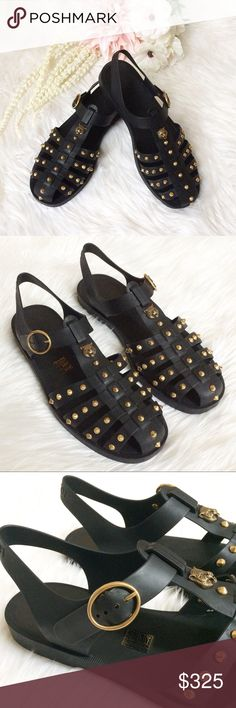 a0efce2ddd2 Gucci Studded Sandals A strap sandal in rubber is embellished with spike  studded hardware and metal