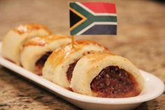 South African Sausage Rolls - A South African favourite of beef and pork blended together and baked in a sour cream pastry. South African Dishes, South African Recipes, Africa Recipes, Cooking Jam, Cooking Recipes, Pie Recipes, Bangers And Mash, Good Food, Yummy Food