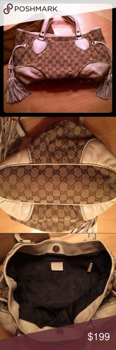 """Gucci Handbag 15"""" length by 8"""" depth. Comes with Gucci dust bag. Tassels on the sides have an adjustable slider to scrunch bag smaller. There's an inside zippered pocket and slot for cell phone (won't fit larger sized phones). In excellent condition. No signs of wear. Gucci Bags Shoulder Bags"""
