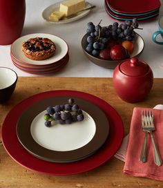 These are my dishes (Noritake Colorwave Chocolate and Raspberry if you want to look up elsewhere). Not sure if I want either the kitchen or dining room to follow this color scheme, but I think I might like one to do so!