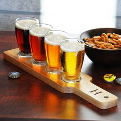 Treat guests to a fun pub-style array of refreshments with this wood beer sampler kit. The set includes a custom-etched paddle and four coordinating pilsner glasses. Each glass holds five ounces of beer, and all pieces are dishwasher safe.