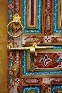 Gorgeous antique door pull and sliding lock on a hand-painted door