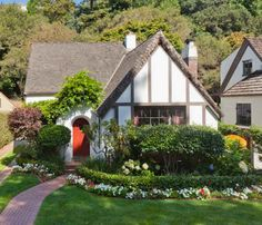 @hooked on houses I fell in love with this cottage in Oakland, Ca from the landscaping all the way to the red front door!
