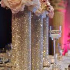 crystal candle holders and flowers on crystal holders