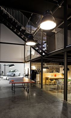 Large industrial style focusse lighting inside the PBlok office