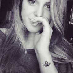 Cool Black Outline Lotus Flower Tattoo On Girl Left Side Wrist