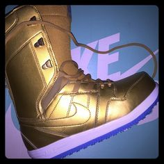 sports shoes 54566 cbbdb Nike SB snowboard boots in gold New never worn 2015 Nike snowboard boots  will do less on also on tradesy Nike Shoes