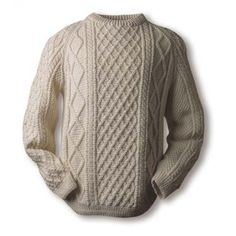 Kennedy sweater, trellis centre panel, flanked by cable, rope, diamond and moss stitches on either side. The trellis represents the stone walled fields of the Aran Islands, the cable is a wish for good luck, and diamond stitch represents a wish for wealth, traditional báinín (pronounced 'baw neen') colour, the natural white of the wool.