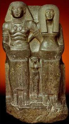 Statue of Sennefer and Senay with their daughter Mutnofret, dyn 18, New Kingdom, black granite, Karnak Temple, Egyptian Museum