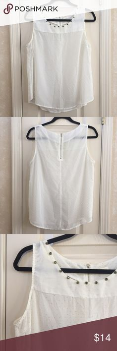 White and Gold Tank White tank top with gold polka dots and a gold studded neckline. 100% polyester. Edge Tops