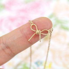 Gold Tiny Bow Charm  Necklace, Bow Necklace, Bridal Shower Gift,Birthday Gift, BFF Gift by Rudiana on Etsy https://www.etsy.com/listing/259819143/gold-tiny-bow-charm-necklace-bow