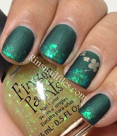 """St. Patrick's Day Designs  by Rin's Nail Files. Used: """"Zoya Veruschka as my base, then using a makeup sponge and Finger Paints Flecked dabbing it onto the tips, finally I stamped with BM-03 using China Glaze Passion as an accent."""""""