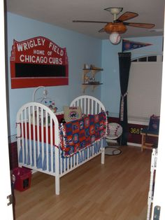 """Rynes """"Little Wrigley Field"""" Nursery, This is a baseball lovers haven, every little boy would love to grow up in a room like this. It has alot of color and simple details that really stand out. I started with a love for the game of baseball & everything that the Chicago Cubs mean to me, I tried to duplicate that for this nursery. I hope you enjoy it!, This is looking in from the doorway. The crib is a classic Delta Luv model in simple white trim.   , Nurseries Design"""