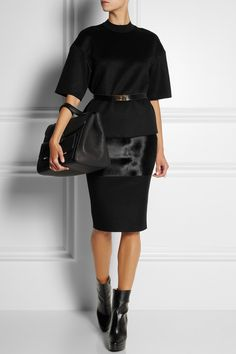VICTORIA BECKHAM Calf hair-paneled felt pencil skirt $1,695 Victoria Beckham's sleek pencil skirt contrasts brown wool-blend felt with black calf hair. This piece first appeared on the designer's acclaimed fall runaway - mirror the show styling with a tonal top and ankle boots.  Shown here with: Victoria Beckham top and bag, Maison Martin Margiela ring, Marni belt, Stella McCartney boots.