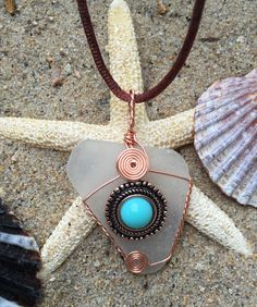 #821 Turquoise Bead on clear seaglass