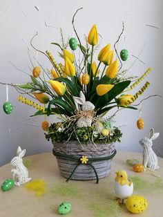 Make them part of a side table display. While you can buy this particular arrangement from Etsy, take note of how adorable it is to work the eggs into a bouquet for a mini tree-like display. Table Arrangements, Floral Arrangements, Flower Arrangement, Egg Tree, Easter Tree, Floral Foam, Holiday Tree, Egg Decorating, Diy Flowers