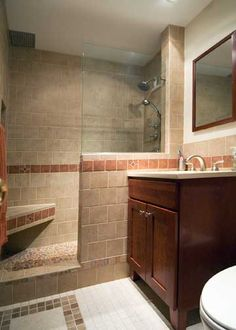Half wall - glass - shower bench (hideous tile, but like the half wall)