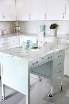 With a few adjustments, a piece of furniture (like this old school desk) can be repurposed as a kitchen island.