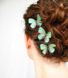 three handmade emerald green silk butterfly hair clips . 'emerald gypsies' . pure dupioni silk. $16.00, via Etsy.