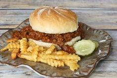 sloppy joe with barbecue sauce and some sausage - Diana Rattray
