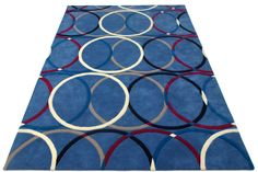 """A custom hand tufted pure wool rug in red, blue, white, grey and black. It has a pile depth of 12-14mm. Created using the """"It's a round rug rug"""" design. #CustomRugRoom"""