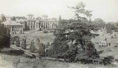 A view of Witley Court. The photographer would have stood in the Deer Park to take this photograph. Taken just after the fire in 1937.