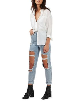 In love with these ultra distressed denim by Topshop. These high waisted jeans will instantly add a touch of grunge to any look.