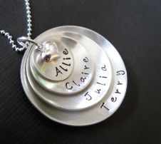 I'm not a MOM, but I have been looking for a necklace to represent my family.  My sweetheart & our girls :)  Renata & Frankie!