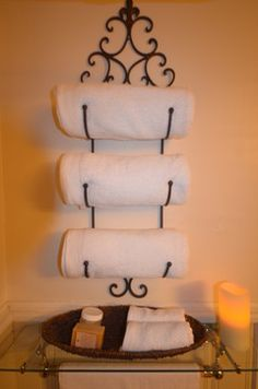 Wine rack used as a towel holder.  Very Chic!