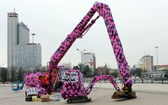 'Yarnbomber' graffiti knit artist Agata Oleksiak Olek covers a digger in wool, Katowice, Poland