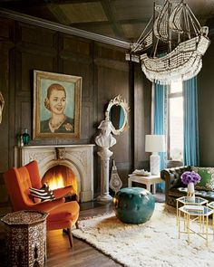 Love the bright colours against the dark walls and that chandelier is INSANE.