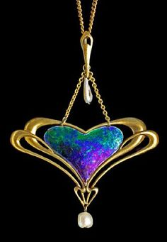 Liberty & Company opal and gold pendant Arts and Crafts an antique style I'm liking and need to investigate more!