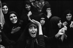 "IRAN. Tehran. Behesht Zahra cemetery. April 1979. On the 40th day after his death, women mourn a ""Martyr of the Revolution"", killed accidentally by a militia friend manning a gun. photo by Abbas"