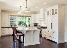 Interior Design Ideas - Vanilla Kitchen! What's not to love? Check out those pendants above the island!!!