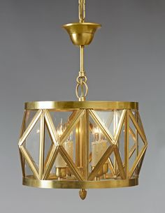 Brass Star rhomboid design drop four light one tier chandelier. Shown with custom vertical pipe height, custom canopy and in standard oxid gold finish.