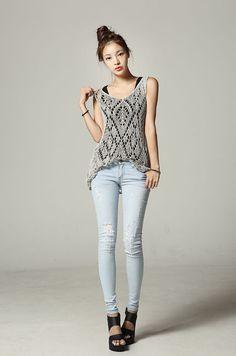 Top knot, skinny jeans, crochet top