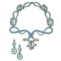 Silver-Gilt, Turquoise, Seed Pearl and Garnet Snake Necklace and Earrings. Designed as a graduated series of coiled snake links set with cabochon turquoises and pearls suspending floral motifs, the eyes set with round garnets, length 16 inches; together with a pair of earrings of similar design; both pieces circa 1830.