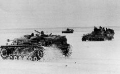 German armored vehicles moving along a snow-covered field near Cherkasy