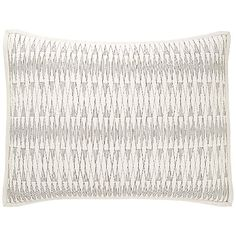 The DwellStudio Loire Pillow Sham completes the sharp look of the Loire Quilt. The geometric, elongated diamond pattern of the stitching was inspired by 1920s Art Deco patterns and architecture (the Chrysler building, for example). Like the duvet cover, the sham is made entirely out of soft, low-maintenance cotton.