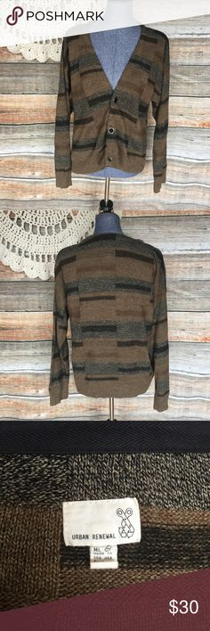 """UO Urban Renewal Brown Striped Cardigan Sweater Urban Renewal recycled black brown striped cardigan sweater. Size Medium/Large. Bust: 42"""" Length: 23"""" All my items have been freshly washed and steamed unless otherwise stated. If you have any questions, feel free to message me. Thanks for stopping by and have a lovely day! Urban Renewal Sweaters Cardigans"""