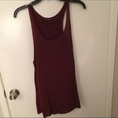 Brandy Melville tank Plain, maroon tank top/tunic. Longer fit but can be tied to be shorter, or worn as a tunic. Worn once. OS. ⭐️Everything in my closet is cheaper on MERC... NO TRADES. Brandy Melville Tops Tank Tops