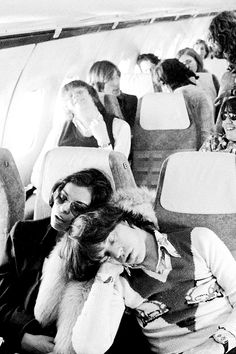 Bianca and Mick Jagger sleeping inside of a plane, 1971.