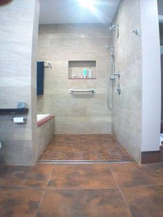 A look into the #shower. Note that the curbless shower provides a clean, modern look and is perfect for wheelchair use.  This user chose to cut the large tile into smaller pieces, but linear drains also accommodate large format tile if desired.