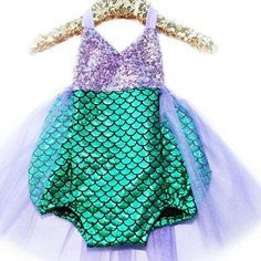 Silver sequin top with green mermaid scale bottoms in spandex and purple sparkle tulle around the bottom makes this the best mermaid outfit around. Perfect for your babies birthday party, pool party, Disney vacation, or under the sea event.