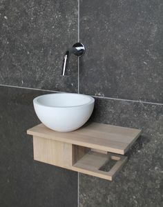 Large is a luxury sometimes. This tiny gem would get the job done and allow a powder room where there was none before.