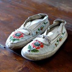 Antique Beaded Moccasins // White Wilderness. via Etsy.