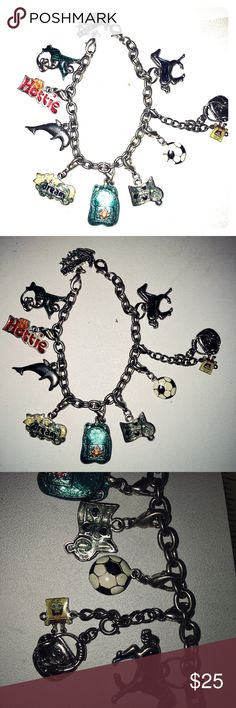 Vintage 10 Charms Bracelet This is a chucky cool vintage charm bracelet with ten different clip on charms including:   Hummingbird, CD player, hottie, gymnastics, backpack, dream clouds & stars, dolphin, music notes, soccer ball, sponge bob, horse. Vintage Jewelry Bracelets